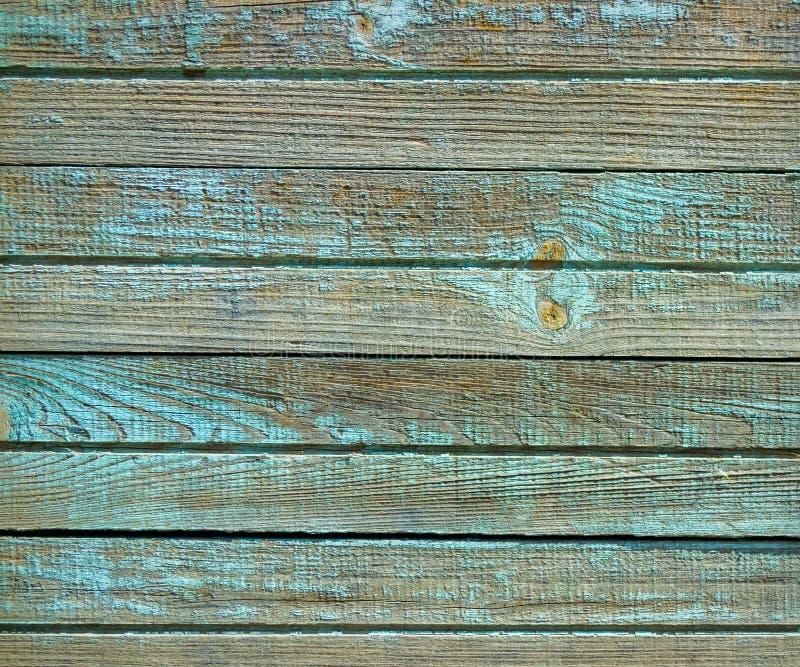 Groene oude geschilderde houten muurtextuur als achtergrond stock afbeelding