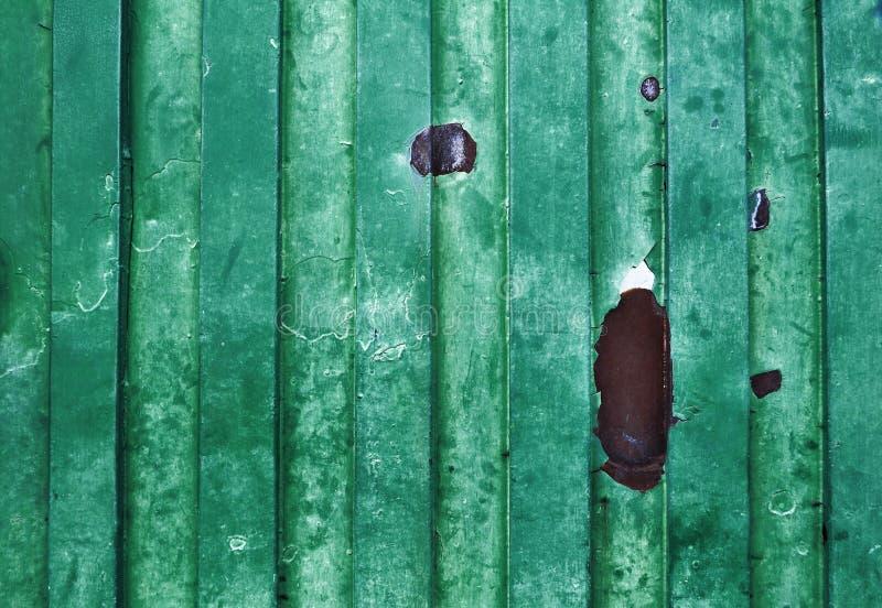 Groene oude grungy metaaloppervlakte - achtergrond - textuur stock foto
