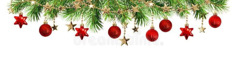 Groene pijnboomtakjes, ballen en slingers voor Kerstmis hoogste grens stock afbeelding
