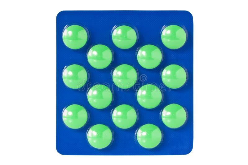 Groene pillen in blaar stock foto