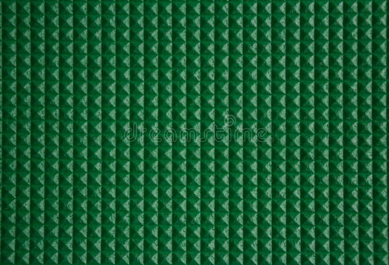 Groene piramidetextuur van een reismat in verticale mening stock foto