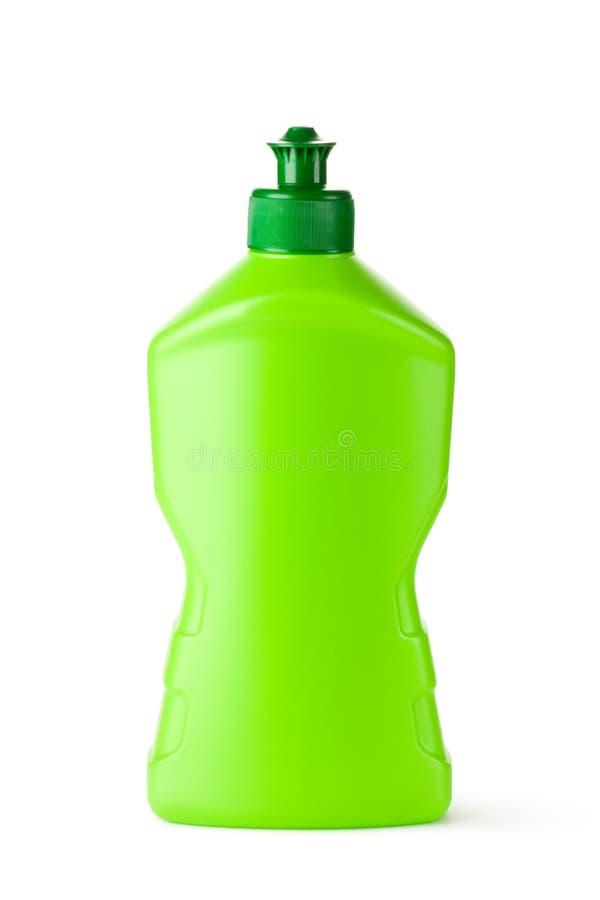 Groene plastic fles met het schoonmaken van vloeistof stock foto's