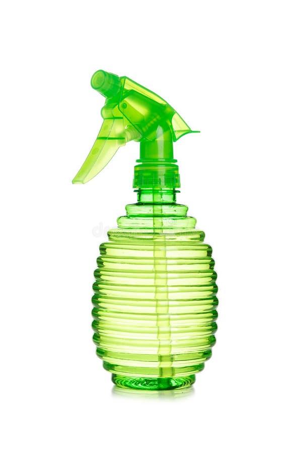 Groene plastic nevelfles op geïsoleerde achtergrond royalty-vrije stock afbeeldingen