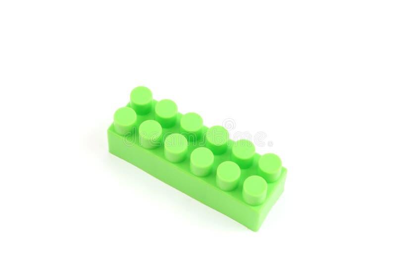 Groene plastic stuk speelgoed baksteen royalty-vrije stock foto