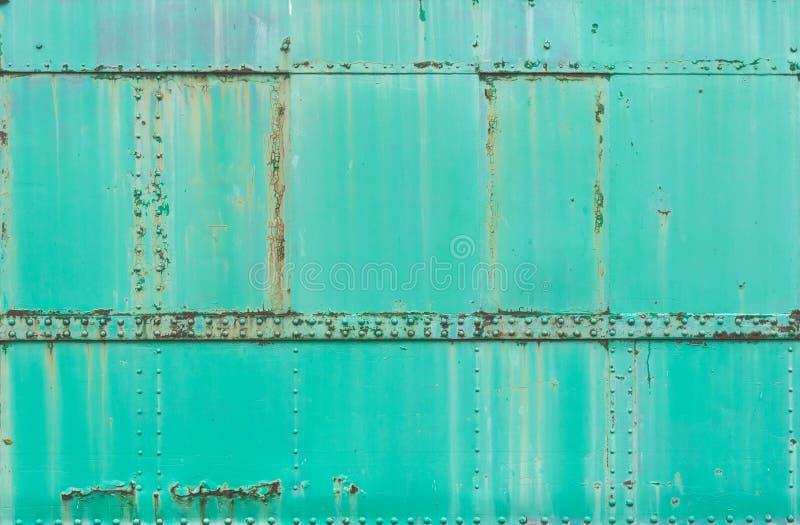 Groene Roestige metaal geschilderde achtergrond, grunge textuur, treinoppervlakte stock foto