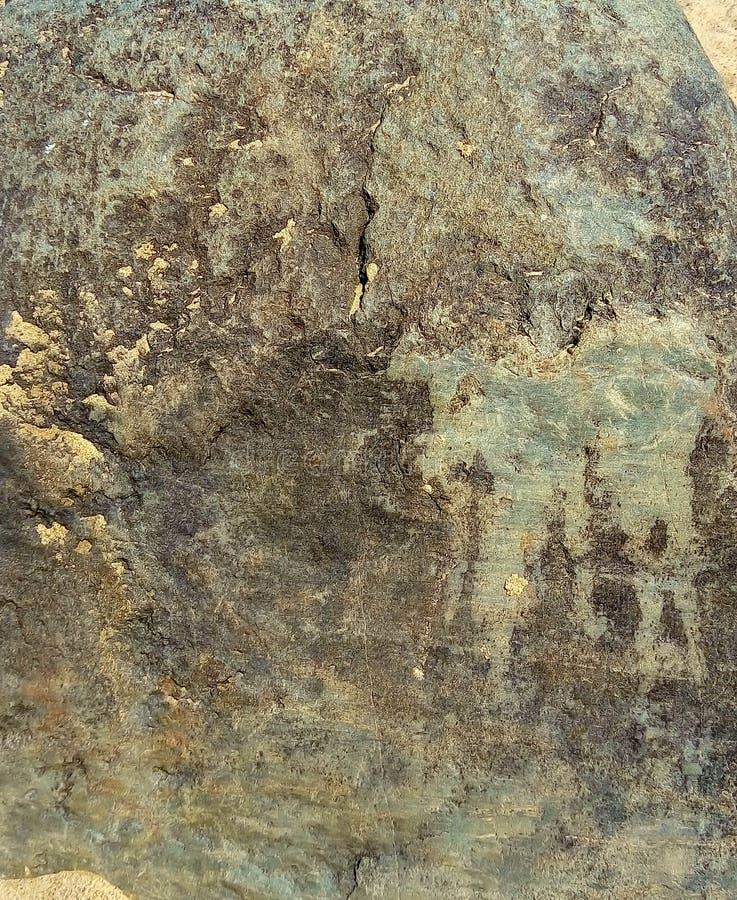 Groene steentextuur op het strand stock afbeeldingen