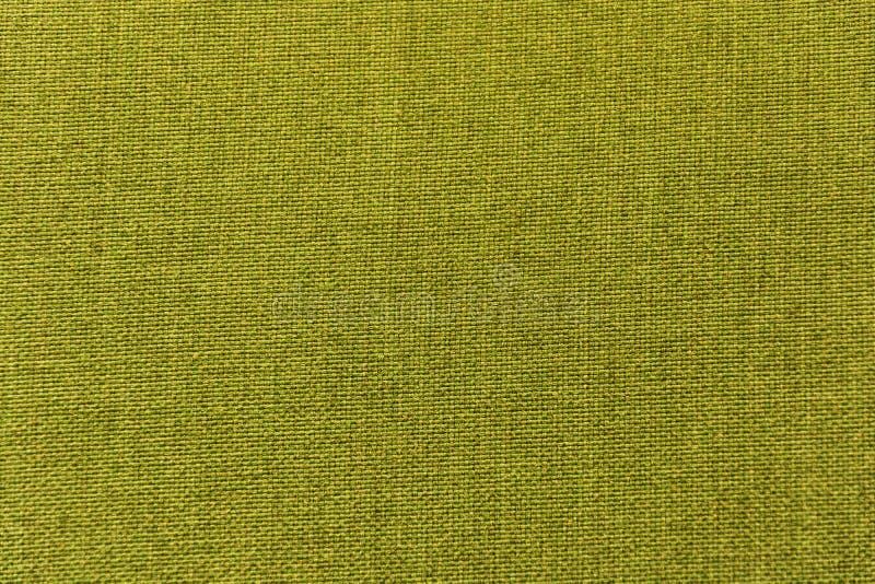Groene stof, materiaal, doek voor textuur, achtergrond, patroon, behang stock afbeelding