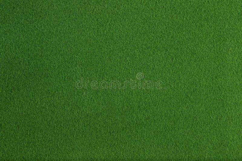 Groene synthetische vacht vlakke textuur en achtergrond stock fotografie