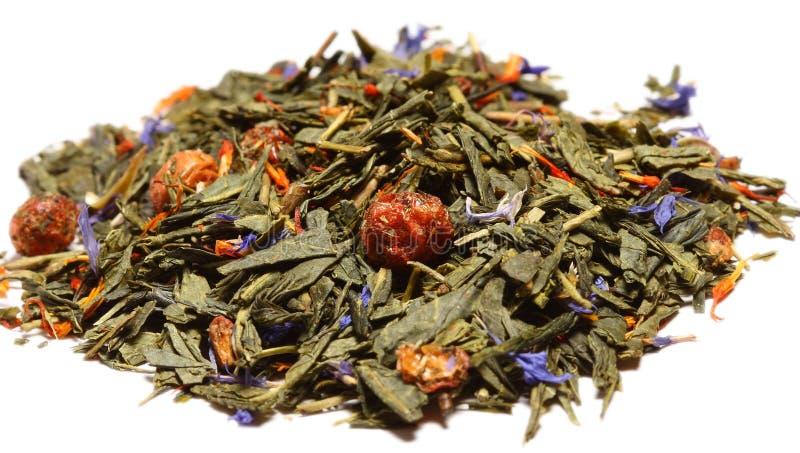 Groene thee met bloemen stock afbeelding