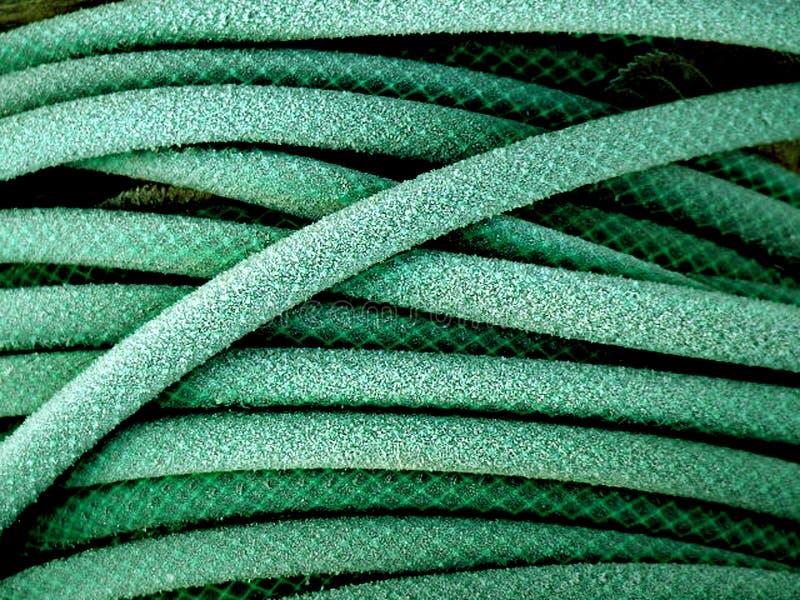 Groene tuinslang royalty-vrije stock afbeelding