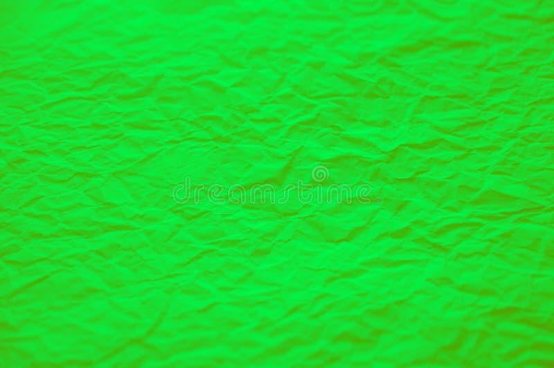 Groene verfrommelde document textuur Groene aardachtergrond stock afbeelding