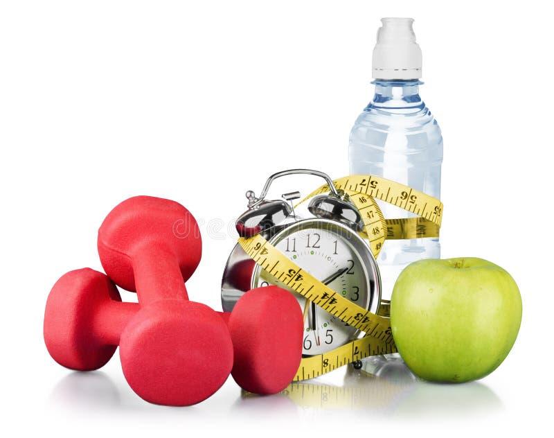 Groene wekker, appel, fles water stock fotografie