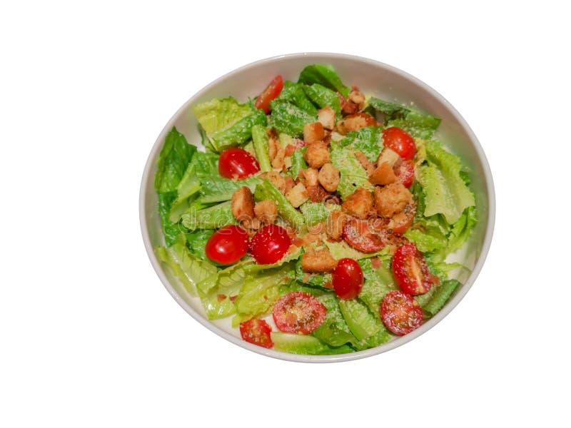 Groenten met Caesar-saladebron over isolate witte achtergrond met in het knippen van weg stock fotografie