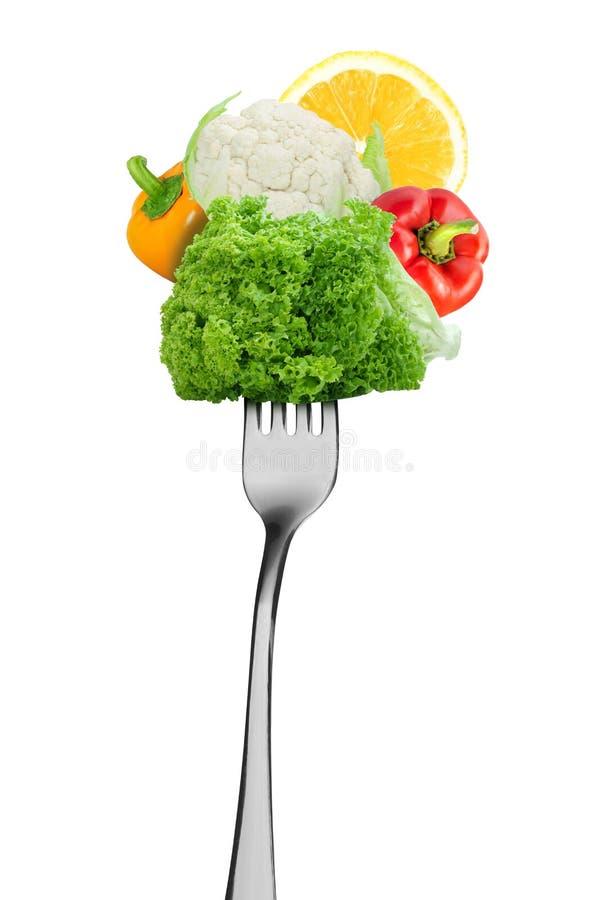 Groenten op de vork Gezond voedsel stock foto