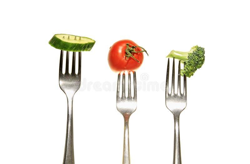 Groenten op een vork stock foto's