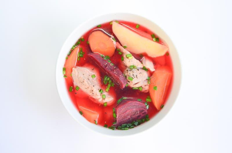 Groentesoep met bieten, wortel, ui en varkensvlees royalty-vrije stock foto's