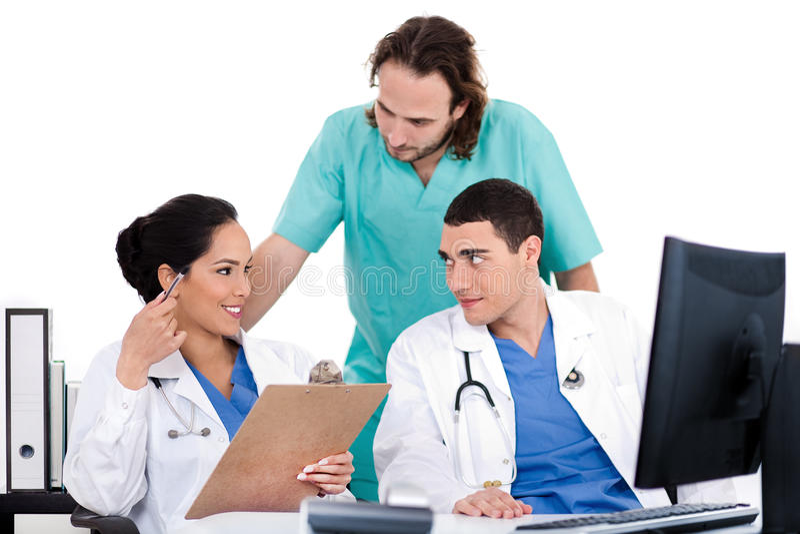Groep artsen in een vergadering bij het ziekenhuis stock afbeeldingen