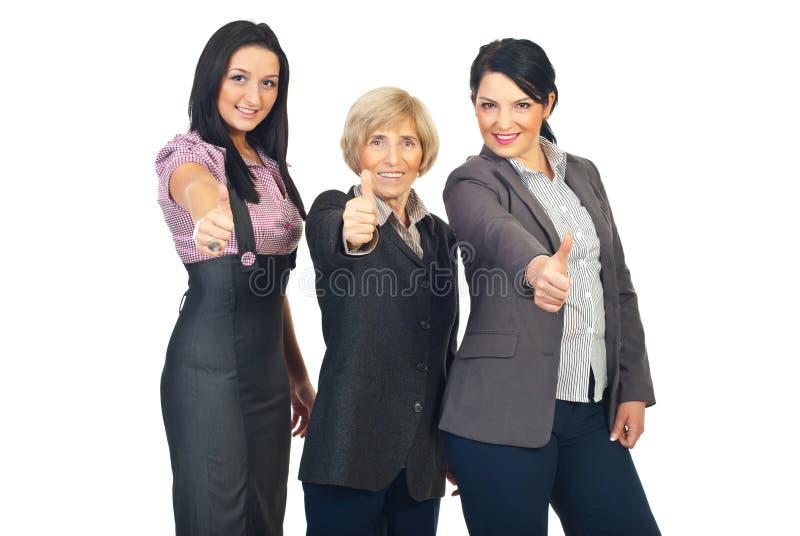 Groep bedrijfsvrouwen die duimen geven stock afbeeldingen