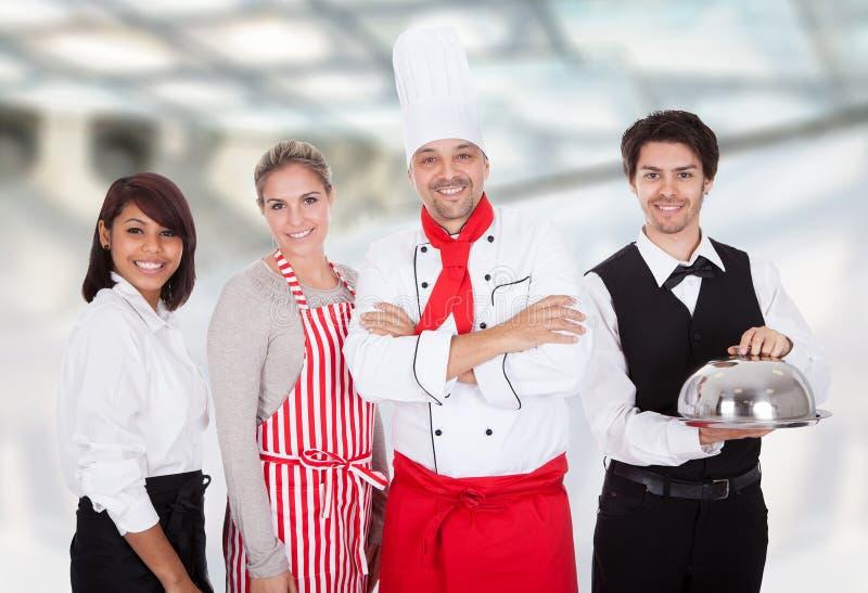 Groep chef-kok en kelners royalty-vrije stock foto