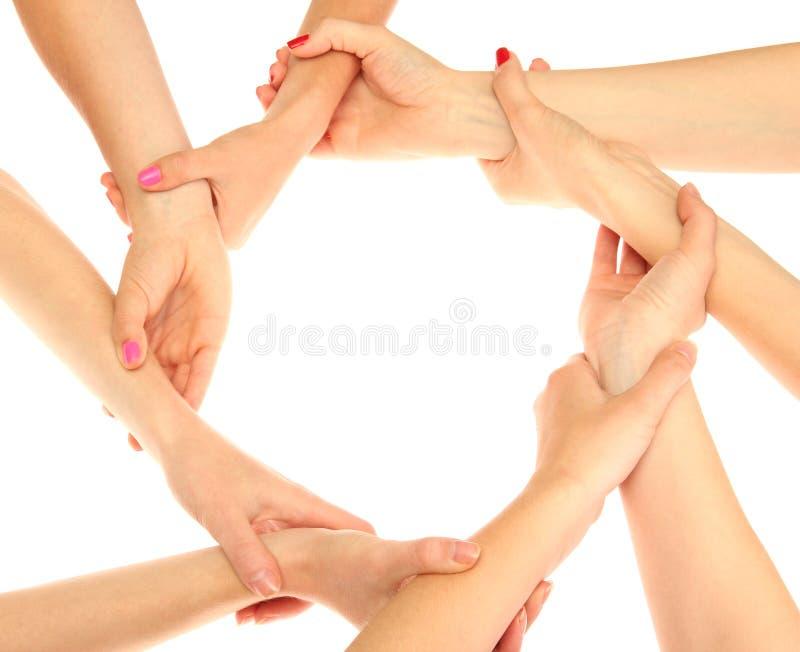 Groep de handen van jonge mensen stock afbeelding