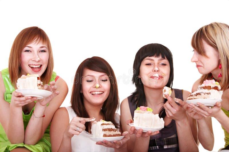 Groep die jonge vrouw cake eet. stock afbeelding