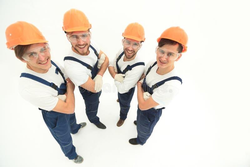Groep die professionele bouwers, de camera bekijken royalty-vrije stock foto