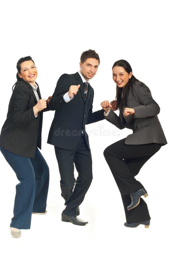 Groep drie het bedrijfsmensen dansen royalty-vrije stock fotografie