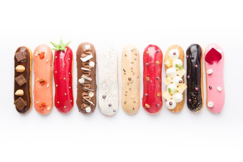 Groep Frans dessert Eclair op witte achtergrond royalty-vrije stock afbeelding
