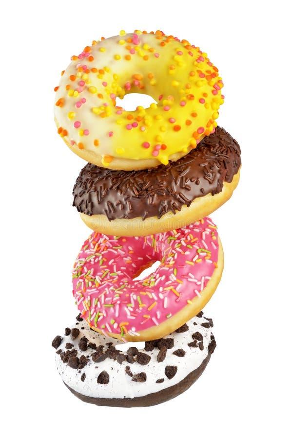 Groep geïsoleerde donuts stock foto's