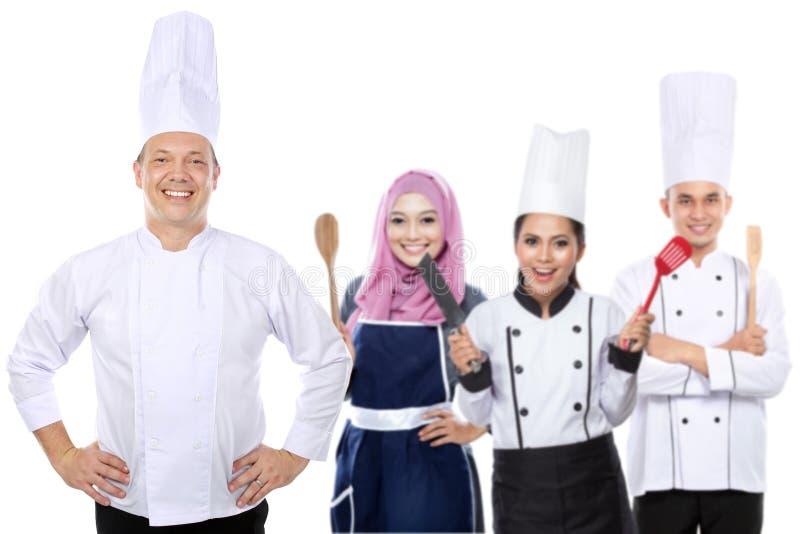 Groep gelukkige chef-kok stock foto