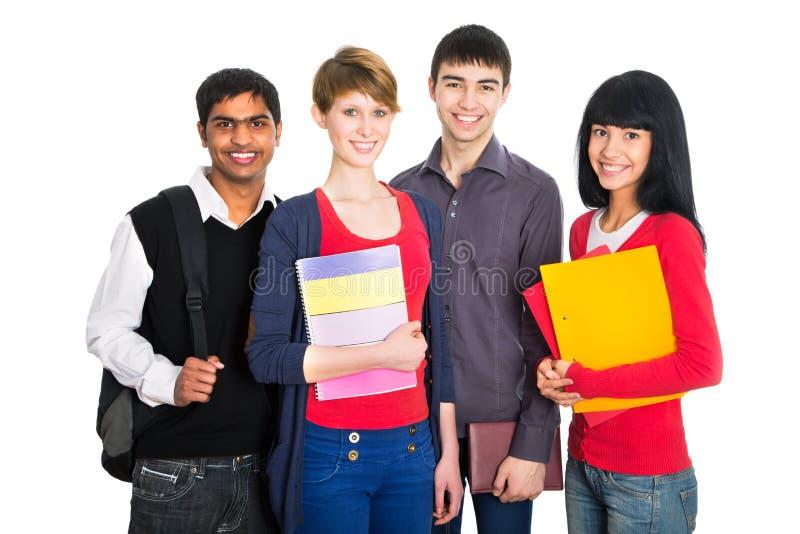 Groep gelukkige studenten stock foto