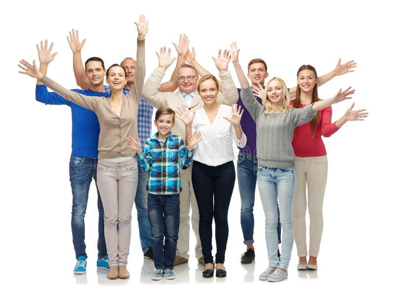Groep glimlachende mensen die handen golven stock afbeeldingen