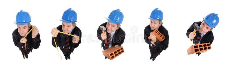 Groep grappige mensen met bouwvakkers royalty-vrije stock foto