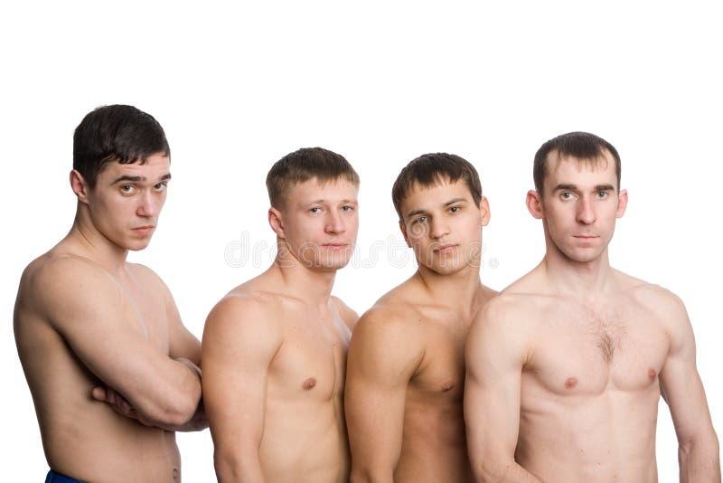 Groep jonge kerels met spierorganismen stock foto's