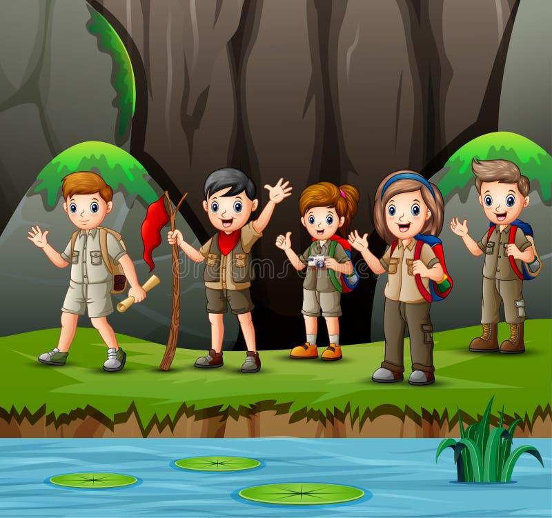 Groep jonge verkennersmeisjes en jongens in aard royalty-vrije illustratie
