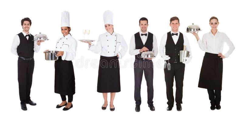 Groep kelner en serveerster royalty-vrije stock afbeeldingen