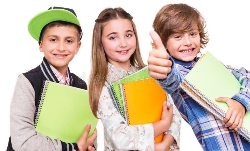 Groep kleine studenten stock afbeeldingen