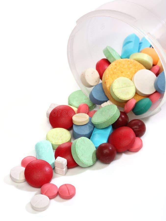 Groep kleurrijke geneeskundepillen royalty-vrije stock afbeelding
