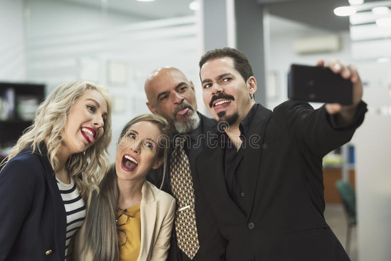 Groep partners in bureau die selfie nemen royalty-vrije stock foto's