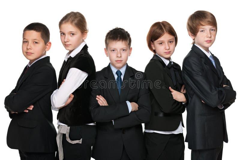 Groep slimme studenten stock afbeeldingen