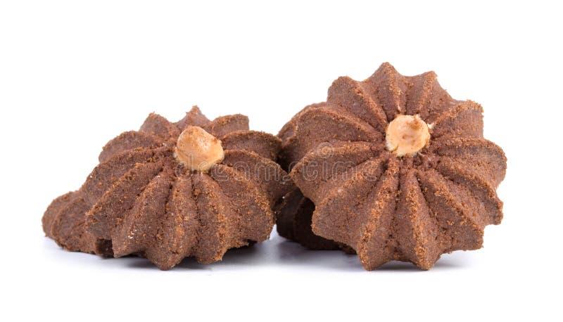Groep smakelijke die chocoladekoekjes op witte achtergrond wordt geïsoleerd stock foto