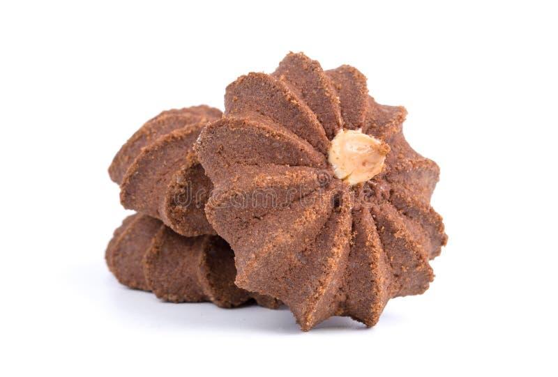 Groep smakelijke die chocoladekoekjes op witte achtergrond wordt geïsoleerd stock foto's