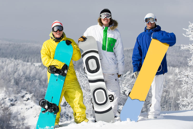 Groep snowboarders stock foto's