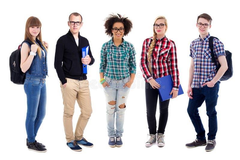 Groep tieners of studenten status geïsoleerd op wit stock foto's
