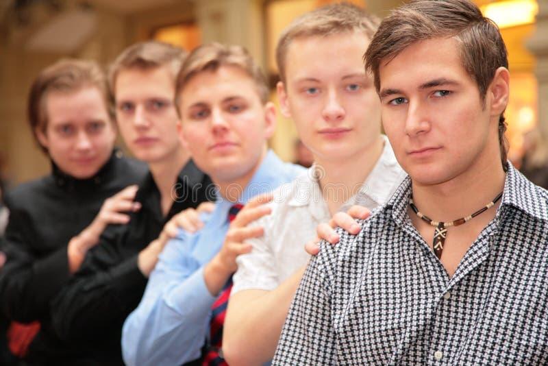 Groep van vijf vrienden royalty-vrije stock afbeelding