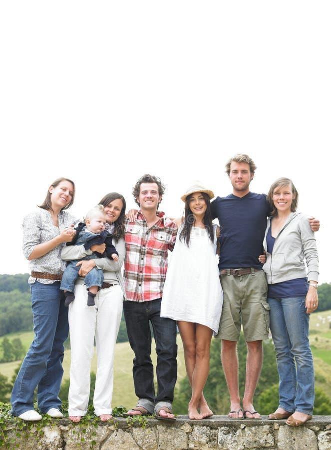 Groep Vrienden die zich in openlucht bevinden royalty-vrije stock fotografie