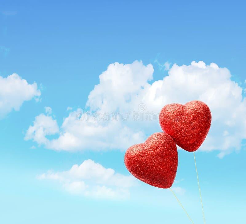 Groetkaart voor de Dag van Valentine ` s, met twee rode harten royalty-vrije stock fotografie