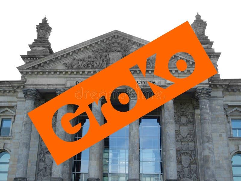 Groko (Grosse Koalition) over Reichstag-het parlement in Berlijn stock afbeelding