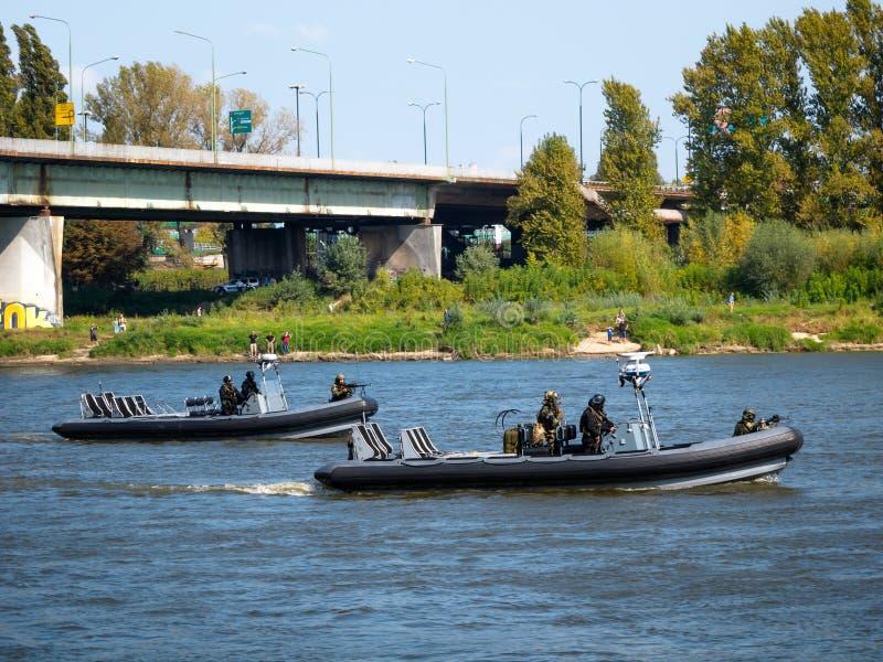 GROM jednostki specjalne na łodziach fotografia stock
