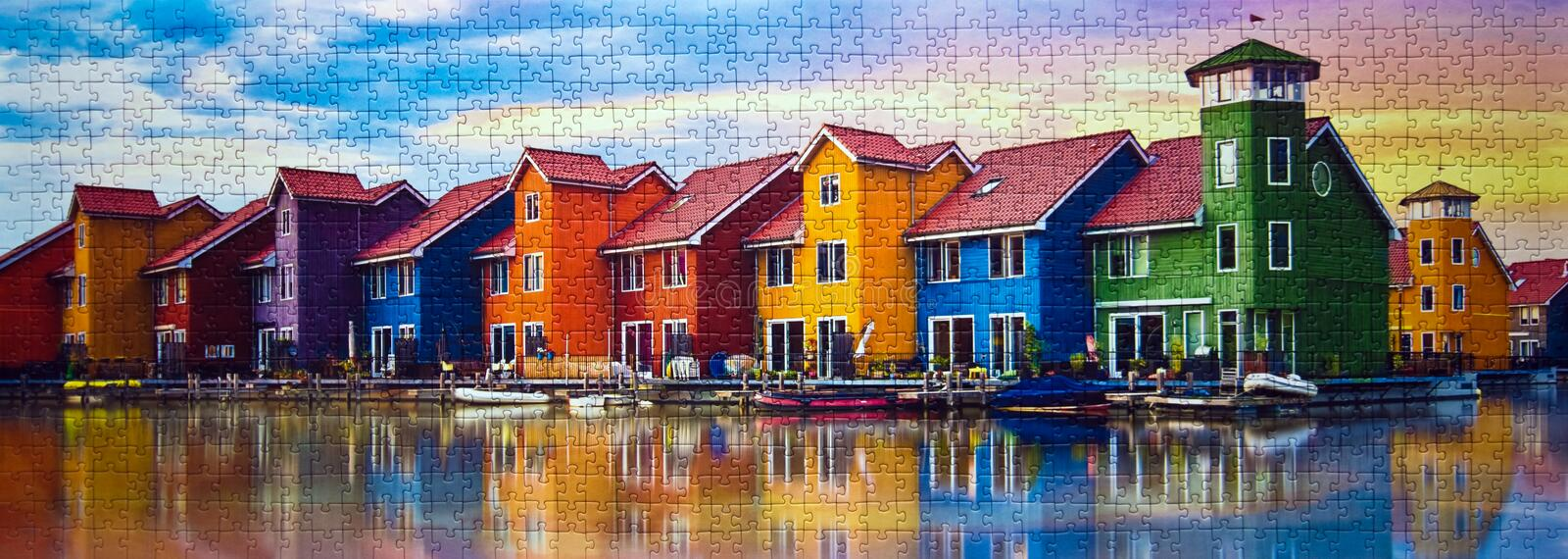 Groningen in Holland colorful houses assembled puzzle image. A commercial toy, Polish manufacturer Trefl puzzle consisting of 1000 elements, assembled puzzle stock photography